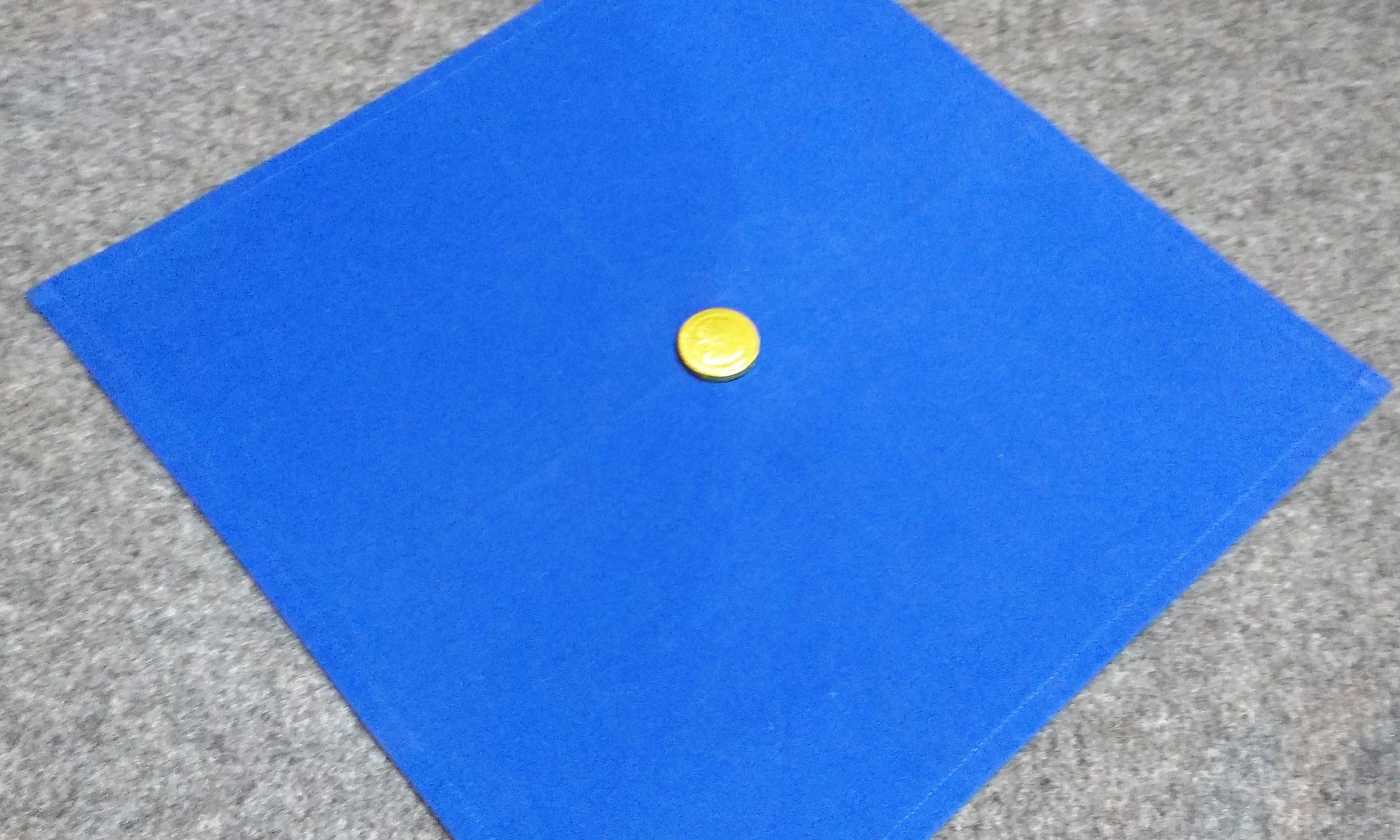 Münze auf dem Tuch
